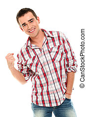 Handsome and young smiling man showing fist
