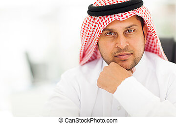 handsome arabic businessman close up