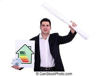 handsome architect showing blueprints