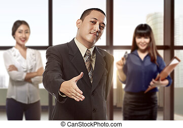 Handsome asian businessman with open hand ready for hand shake