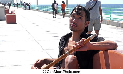 Handsome Asian Tourist on the Pier - Handsome Asian man...
