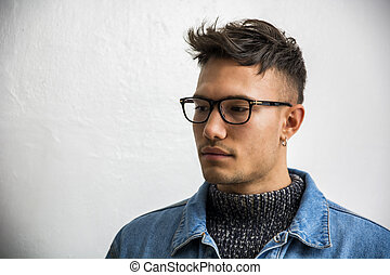 Handsome asian-white young man wearing grey sweater
