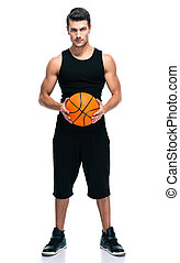 Handsome basketball player with ball