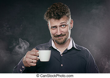 Handsome beard man stand in fog with cup of coffee