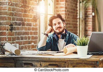 Handsome Bearded Architect Sitting At His Desk