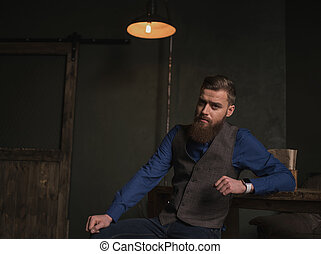 Handsome bearded businessman is resting at home
