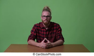 Handsome bearded hipster man being interviewed against...