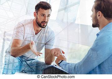 Handsome bearded man explaining his problem to psychiatrist...