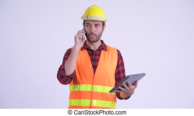 Handsome Bearded Persian man construction worker...