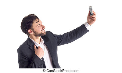 Handsome bearded young business man taking selfie smiling. portrait isolated over white studio background.