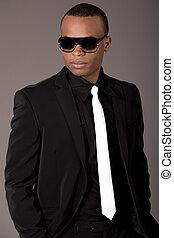 Handsome black man in business suit, indoor studio