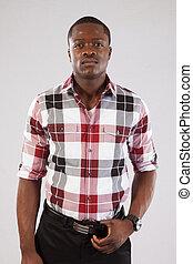 Handsome Black man in plaid shirt