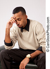 Handsome black man thinking - Handsome black man sitting and...