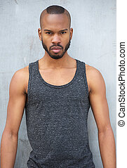 Handsome black man with intense look - Portrait of a...