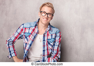 Handsome blonde man smiling at the camera.