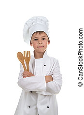 Handsome boy in chef uniform holding wood cutlery, isolated on white background.