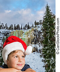 Handsome boy in red Santa Claus hat