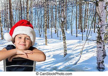 Handsome boy in Santa Claus hat smiling