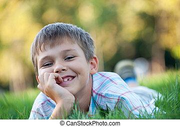 Handsome boy in the autumn park