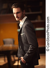 handsome brunet man - Handsome brunet man in an elegant suit...