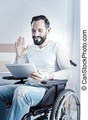 Handsome brunette male waving hand