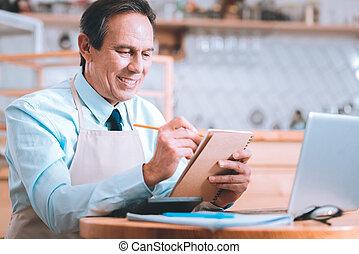 Handsome brunette man sitting in cafe