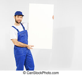 Handsome builder with white board
