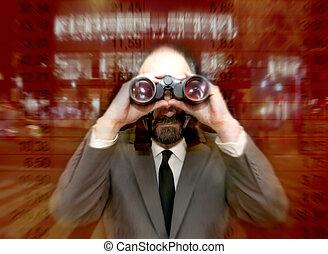 Handsome business man, bald and bearded, looking through binoculars