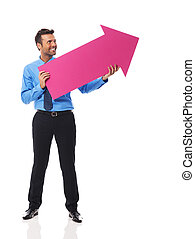 Handsome business man holding pink arrow and pointing at copy space