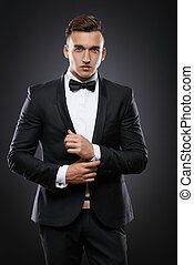 business man in suit on a dark background - handsome...