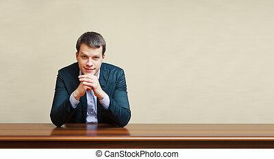 business man on a desk - handsome business man on a desk