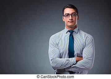 Handsome businessman against gray background