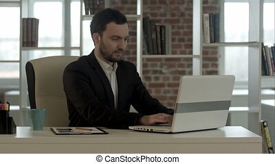 handsome businessman at office close notebook, stop working