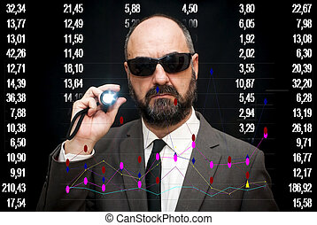 Handsome businessman, bald and bearded, wearing sunglasses and a lighted lantern in hand pointing to the financial graphics on black background with white numbers