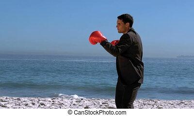 Handsome businessman boxing
