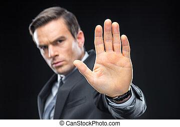Handsome businessman gesturing