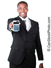 Handsome businessman holding a calculator