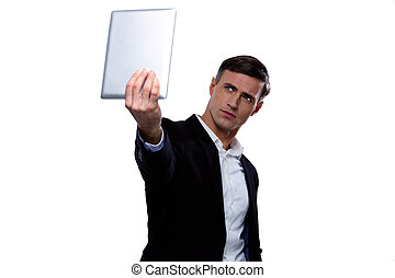 Handsome businessman holding tablet computer and looking at it