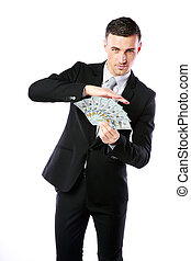Handsome businessman holding US dollars isolated on a white background