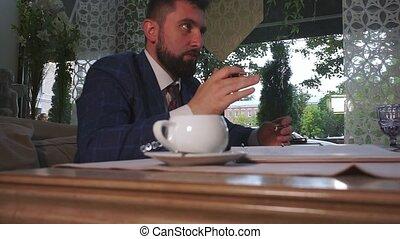 handsome businessman holds important conference slow motion...
