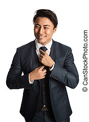 Handsome businessman in a blue suit and tie