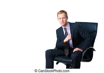 handsome businessman in black office chair