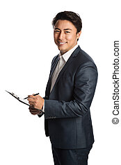 Handsome businessman in blue suit with clipboard