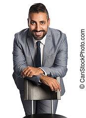 Handsome businessman in grey