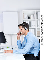 Handsome businessman in office wearing a headset