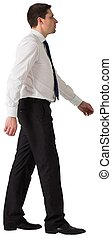 Handsome businessman in shirt and tie stepping