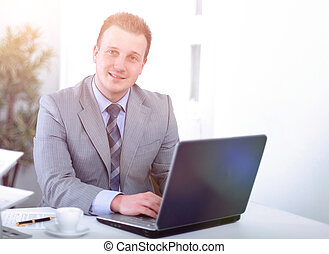 Handsome businessman is working in a office