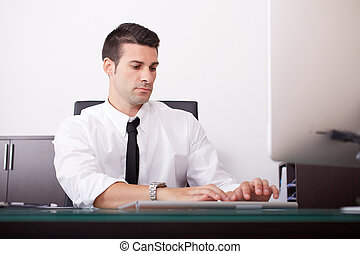 Handsome businessman is working in office