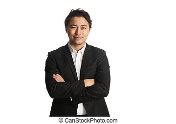 Handsome businessman looking at cam - An attractive...