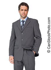 Handsome businessman looking at camera